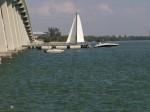 sailboat under bridge